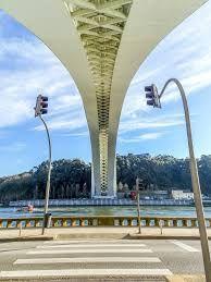 The Arrábida Bridge is an arch bridge of reinforced concrete, that carries six lanes of traffic over the Douro River, between Porto and Vila Nova de Gaia, in Norte region of Portugal. #arrabidabridge #oportobridges #architecture