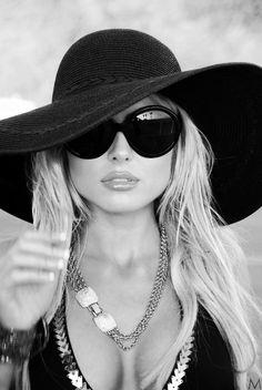 Big hats, big shades, big necklaces