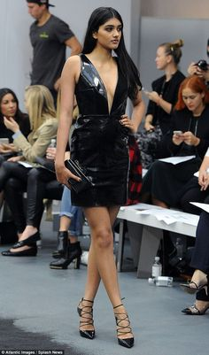 Model behaviour: The Coventry-born beauty, who now lives in London, wore her long silky tresses in a centre parting and posed with her hand on her hip prior to the show