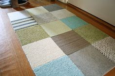 DIY Rug - Use carpet samples ( usually $1 or so each), hot glue them together add some carpet tape & you're done.