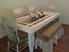 Shabby and Fabulous-- Harvest dining table  & 4 chalk paint chairs--  Custom burlap bench w/ skirt $1200. Made from old door, architectural posts, original patina. https://www.facebook.com/SeasideCottageStyle