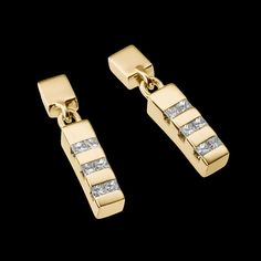 """Devotion Diamond Dangle Earrings"" - 14-karat yellow gold earrings with twelve diamonds, 0.67 total carat weight."