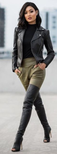 A black leather biker jacket and army green tapered pants are perfect for both running errands and a night out. Black leather over the knee boots will add elegance to an otherwise simple look.   Shop this look on Lookastic: https://lookastic.com/women/looks/black-biker-jacket-black-turtleneck-olive-tapered-pants/23361   — Black Turtleneck  — Black Leather Biker Jacket  — Olive Tapered Pants  — Black Leather Over The Knee Boots