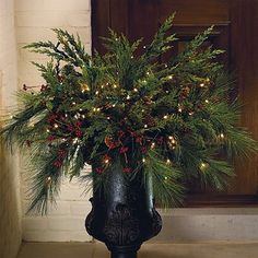 urns decorated for christmas | Black urn, plus greenery and lights = ... | Christmas Decorating