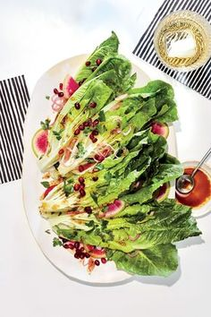 Crunchy Greens with Radish | Letting the raw shallot stand with the salt and vinegar pickles it slightly and mellows the harshness of raw onion. Long spears of romaine make a dramatic presentation. Once brought to the table, you can coarsely chop the lettuce for easier serving.
