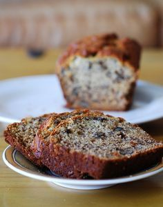 Moist banana bread with walnuts by JuliasAlbum.com, via Flickr~ 3 ripe bananas, smashed 1/3 cup melted butter 3/4 cup sugar 1 egg, beaten 1 teaspoon vanilla extract 1 teaspoon baking soda Pinch of salt 1 1/2 cups all-purpose flour 1/2 cup walnuts, chopped Preheat the oven to 350 F.