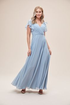 This long chiffon bridesmaid dress gives an aura of dreamy romance from the softly pleated, plunging-V neckline to the billowy, floating full circle skirt. The faux-wrap style bodice is finished with soft, flattering flutter sleeves. Available in Sydney, Melbourne & Online. Flattering Bridesmaid Dresses, Cheap Bridesmaid Dresses Online, Bridesmaid Dresses With Sleeves, Bridesmaid Dresses Plus Size, Bridesmaid Dresses Australia, Full Circle Skirts, Gowns Online, Online Dress Shopping, Gold Coast