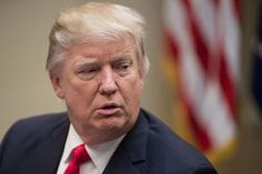 Trump defiant, Obama weighs in as travel ban fury mounts
