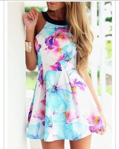 Love the colors of the flowers on this cute little summer dress!