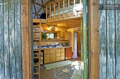 a beautiful tiny house shaped like a mushroom, consists of a semi-rustic cabin under a geodesic dome surrounded by oak, redwood and madrone trees. The cabin has a double bed located in the loft, an LCD screen with DVD player, a small deck, a couch, a small hot plate, refrigerator, toaster oven, blender and other kitchen supplies. The cabin has a tiny bathroom and shower.