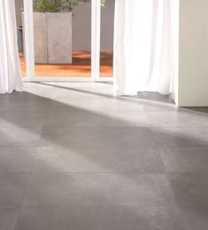 Porcelain stoneware floor tile: concrete look - URBAN CONCRETE : NIGHT - FLAVIKER PISA - Videos