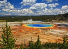 Grand Prismatic Spring Yellowstone National Park, Wyoming Family Travel Hotels National Parks Trip Ideas sky wilderness ecosystem Nature Lake sport venue River landscape reservoir wetland plateau marsh national park pond park clouds shore day