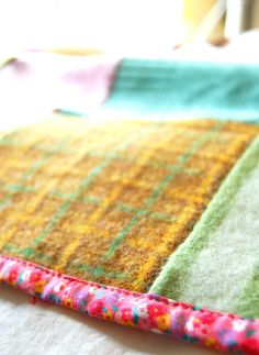 add some floral binding to a wool blanket. so cool