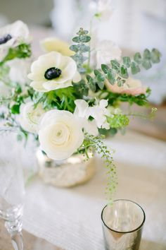 white floral low centerpieces with mercury glass vases | Photography: Love & Light Photographs