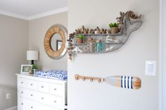 How nice to have a little nook in the nursery to tuck your changing table!