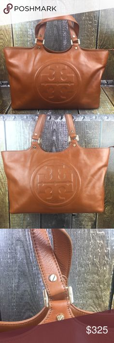TORY BURCH bomber leather satchel Tory Burch AUTHENIC bomber satchel, rich looking chestnut brown leather, embossed signature logo, interior zippered pocket, 2 interior side pockets, clean interior, no knicks or scratches. Absolutely gorgeous!  No trades. Offers Welcome. BUNDLE DISCOUNT NOT APPLICABLE! Tory Burch Bags Satchels