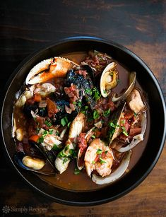 Cioppino by simplyrecipes: San Francisco-style cioppino Italian fish stew, with fresh halibut, sea bass, Dungeness crab, shrimp, clams, mussels, and oysters in a savory tomato-based broth.  #Seafood #Cioppino