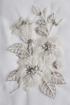 motif with delicately beaded flowers and silver threadwork Hand-made motif with delicately beaded flowers and silverHand-made motif with delicately beaded flowers and silver Bead Embroidery Tutorial, Bead Embroidery Patterns, Hand Work Embroidery, Hand Embroidery Designs, Beaded Embroidery, Embroidery Stitches, Kashida Embroidery, Couture Beading, Couture Embroidery