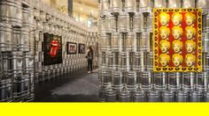 LIKEarchitects: the andy warhol temporary museum - building-up by designboom. this temporary exhibition space within a shopping mall in lisbon featured the works of andy warhol. the design was based on both pop and industrial references, raw aluminum paint cans were stacked on top of one another to form the structure.