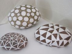 Paint some pretty rounded rocks and display in a bowl, vase, or on their own.