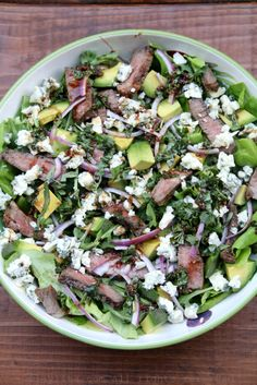 Steak salad with blue cheese, avocado, and basil balsamic dressing