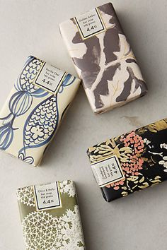 Winter Blooms Soap Bar at anthropologie -- (vanilla chai, citrus & holly, cranberry cedarbark, golden amber) $7.00 ea