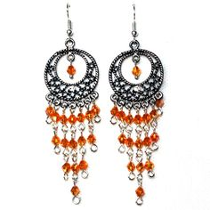 Lovely Handmade Chandelier Earrings These earrings showcase a cascade of golden colored crystals. They will make a great addition to your wardrobe. Approximate size: 8 cm long x 2 cm wide  I used Tibetan silver, alloy and crystals with a unique golden/orange hue and a fish hook for comfort.  Please keep in mind that colors may vary according to your screen settings.  I send my orders by registered letter of Correos (Spain Mail Post Service)  Please, feel free to contact me.  Thanks for…
