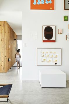 Low-cost materials like plaster board, knotty cedar, and polished concrete appear in the #gallery as well as in the residence. #home #newzealand