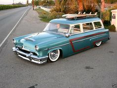 1954 Mercury 4Dr. Wagon with Custom Wood Veneer Scalloped Side-Moldings, with the car also being lowered.