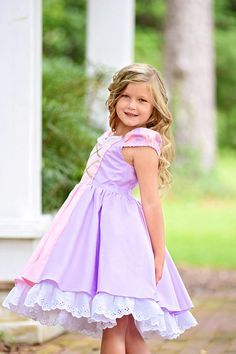 This stunning girls Rapunzel dress offers EVERYTHING she could wish for! The design is just perfect with layers of skirting in gorgeous fabrics with beautiful details such as the sparkling gold sequin trim and ruffled edge ribbon on the bodice. Its also lined in a scrumptious