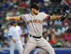 CHICAGO, IL - AUGUST 20: Jake Peavy #22 of the San Francisco Giants pitches against the Chicago Cubs during the first inning on August 20, 2014 at Wrigley Field in Chicago, Illinois. (Photo by David Banks/Getty Images)