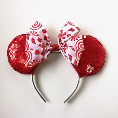 A personal favorite from my Etsy shop https://www.etsy.com/listing/258694684/candy-cane-mickey-ears-red-sequins