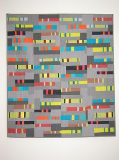 Love the colors, design, simple quilting, and improv process of this, gotta try it!