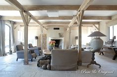 flagstone floor, exposed beams, warm grey, adobe, fireplace, refined rustic