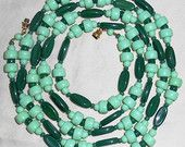 49 inch long vintage glass bead necklace made of different shapes and shades of green beads for sale at: https://www.etsy.com/listing/197720765/49-inch-long-vintage-glass-bead-necklace?ref=shop_home_active_12