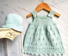 Sweet little sun dress with matching hat. This is a relatively easy knit with just a little lace trim at hemline, and eyelet pattern on skirt, and the length is easily adjusted. Knits up quickly. Perfect for the summer months!Extra materials required4 buttons for dress,Stitch holders. The pictured outfit was knitted up in Rico Baby Cotton Soft DK.YARN REQUIRED.DRESS ONLY   -- Sizes A