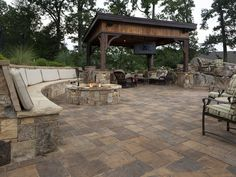 For this extensive outdoor living space, Belgard's Mega-Lafitt modular pavers , which have the look of cut flagstone, are used for the fire pit and bench seating.