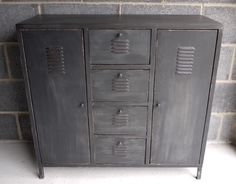 This storage unit has an industrial look and would be fabulous in a family room or reception area.