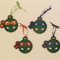 My TMNT magnets have big smiles on their faces but I wanted these bad boys to have a bit more attitude. :). Get my new ornaments in my #etsyshop at http://etsy.me/1Mg6Mr8. #etsy #ebaystore #pixelart #perler #perlerart #perlerbeads #tmnt #teenagemutantninjaturtles #ninjaturtles #raphael #leonardo #donatello #michaelangelo #retro #90s #90skid #80sbaby #christmas #christmasornaments #ornaments