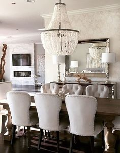 Dining Room decor ideas - Wood table, crystal chandelier, upholstered, tufted chairs.