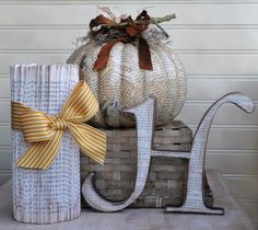 Book pages mod podged onto pumpkins, made into pillars, and letters - lots of great ideas here