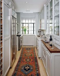 long narrow kitchen We found numerous long narrow kitchen layout ideas, and there are probably more available online. For more go to We found numerous long narrow kitchen layout ideas, and there are probably more available online. Galley Kitchen Design, Small Galley Kitchens, Kitchen Rug, Home Kitchens, Kitchen Runner, Kitchen Designs, Kitchen Wood, Kitchen White, Kitchen Carpet