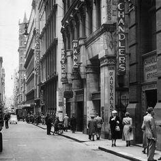 """Flinders Lane, nth side, looking west towards Elizabeth from around Manchester Lane. Everything from the """"Macks"""" sign to Elizabeth, demolished but everything to its right survives protected today. Melbourne Laneways, Melbourne Cbd, Melbourne Victoria, Victoria Australia, Places In Melbourne, Melbourne Suburbs, Australian Continent, Landscape Photos, Historical Photos"""