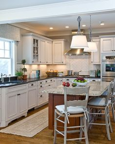 Like contrast b/n cream cabinets and brown island as well as different countertops. & like the backsplash