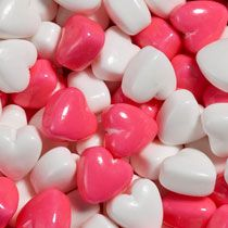 These cute little Cupid Hearts candies in pink and white match any party decorating theme, and are a fantastic choice for filling favor boxes.