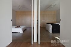 Bridge House 2 by Delia Teschendorff Architecture | Shortlisted Houses Awards | Shortlisted Victorian Architecture Awards | Interior Design | Bedroom Inspiration | Hidden Bathroom | Lovely Robes | Creative Details | Courtyard Views | Natural Light | Tranquil Space | Timber
