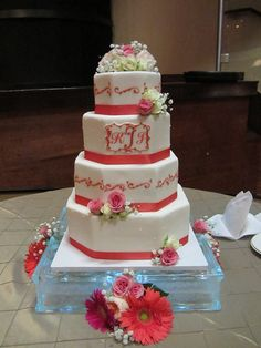 Coral and white octagonal wedding cake