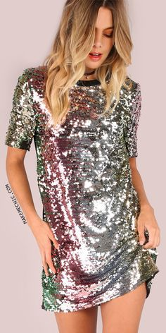 """Casual fit with a vibrant look. Featuring a short sleeve shirt dress with gorgeous ombre sequin detailing, an underlining dress and back zip closure. Dress measures 32"""" in. from top to bottom hem. Keep it simple with, strappy heels and two tone jewelry."""