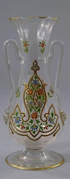 A Lobmeyr style twin handled clear glass vase, made for the Turkish Market, 19th century, of waisted bulbous form on a spreading glass foot, gilded and enamelled with flowers and leaves, 20.5cm. high