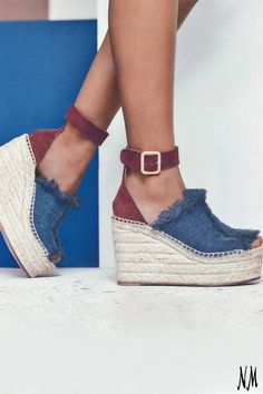 Anticipating the arrival of spring with these Chloé frayed denim wedges. Pair with a chiffon skirt and off-the-shoulder blouse for a romantic look.